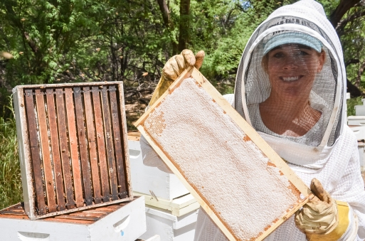 Amy and Michael with the bees | Rare Hawaiian Honey Company | whiskandmuddler.com